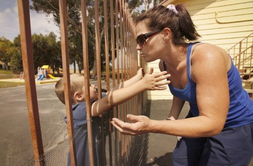 Antoinette Levenson kisses her son Jaden, 4, after dropping him and his brother Gavyn, 2, off at Canyon Vista Children's Center in Chatsworth. The state pays about $1,000 a month for their care while she finishes school.