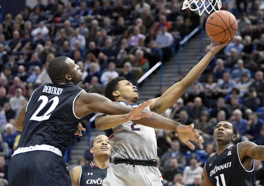 Connecticut's Jalen Adams (2) is fouled by Cincinnati's Coreontae DeBerry (22) during the first half of an NCAA college basketball game in Hartford, Conn., on Thursday, Jan. 28, 2016. (AP Photo/Fred Beckham)