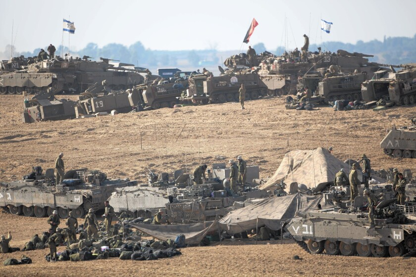 Israeli soldiers and tanks are deployed July 10 along the border with the Gaza Strip.