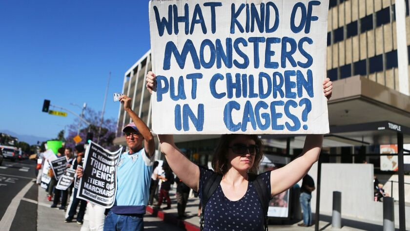 Protesters demonstrate against the separation of migrant children from their families in front of the federal building in downtown Los Angeles on June 18.