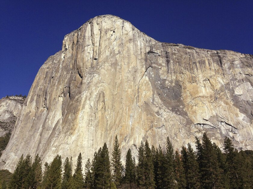 FILE - In this Jan. 14, 2015, file photo, shows El Capitan in Yosemite National Park, Calif. The names of iconic hotels and other facilities in the world-famous Yosemite National Park will soon change in an ongoing battle over who owns the intellectual property, park officials said Thursday, Jan. 14, 2016. The move comes in an ongoing dispute with Delaware North, the company that lost a $2 billion bid, the National Park Services largest single contract, to run Yosemite's hotels, restaurants and outdoor activities. (AP Photo/Ben Margot, File)
