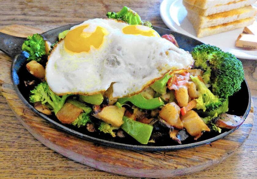 At Monkey Business, breakfast — including this vegetable-laden eggs-and-potatoes skillet — is served all day.