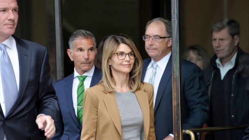 Lori Loughlin, 15 others indicted on new charges in college