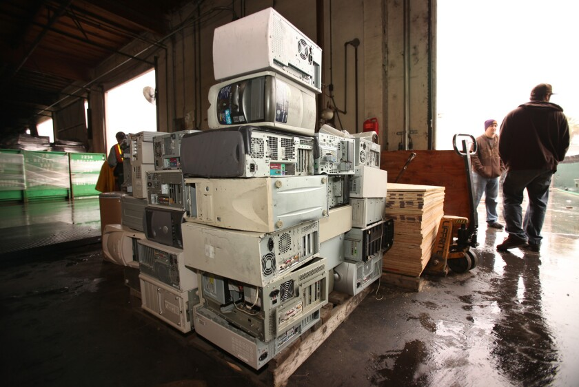 Old computers and other electronics must be taken to a specialty recycling center, such as this one in Paramount, where items are disassembled.