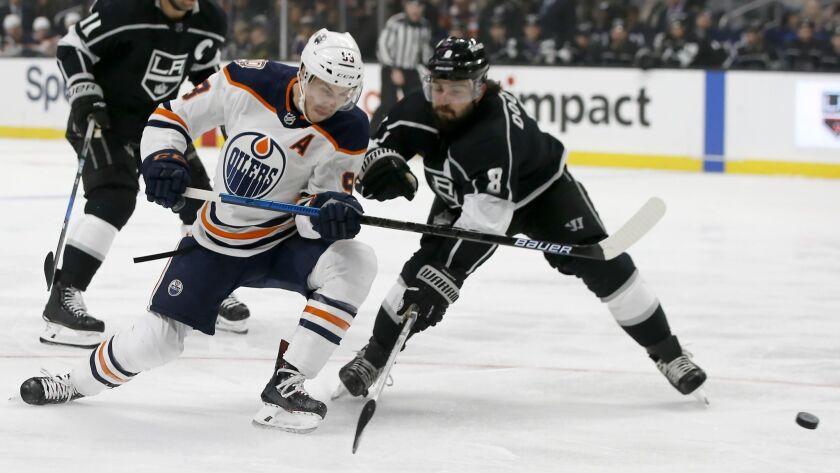 Edmonton Oilers center Ryan Nugent-Hopkins, center, shoots a backhander with Los Angeles Kings defen