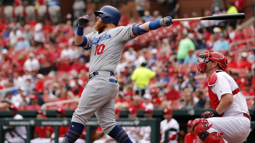 Los Angeles Dodgers' Justin Turner (10) and St. Louis Cardinals catcher Matt Wieters watch a sacrifi