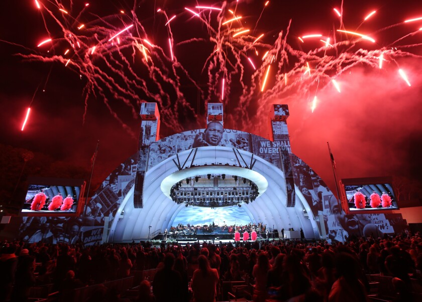 A look at the stage, audience and fireworks during the Hollywood Bowl's season-opening night featuring singer John Legend.