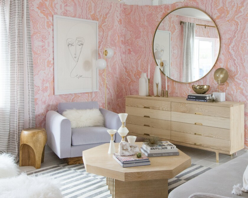 Pink agate wallpaper designed by Sarah Sherman Samuel lines the walls in a Palm Springs guest bedroom.