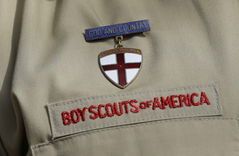 FILE - This Feb. 4, 2013 file photo shows a close up of a Boy Scout uniform badge during a news conference in front of the Boy Scouts of America headquarters in Irving, Texas. A team of lawyers filed a lawsuit on Monday, Jan. 6, 2020, in federal court in Washington, D.C., seeking to establish the nation's capital as a venue for men across the U.S. to sue the Boy Scouts of America for allegedly failing to protect them from long-ago sexual abuse at the hands of scoutmasters and other scout leaders. (AP Photo/Tony Gutierrez, File)
