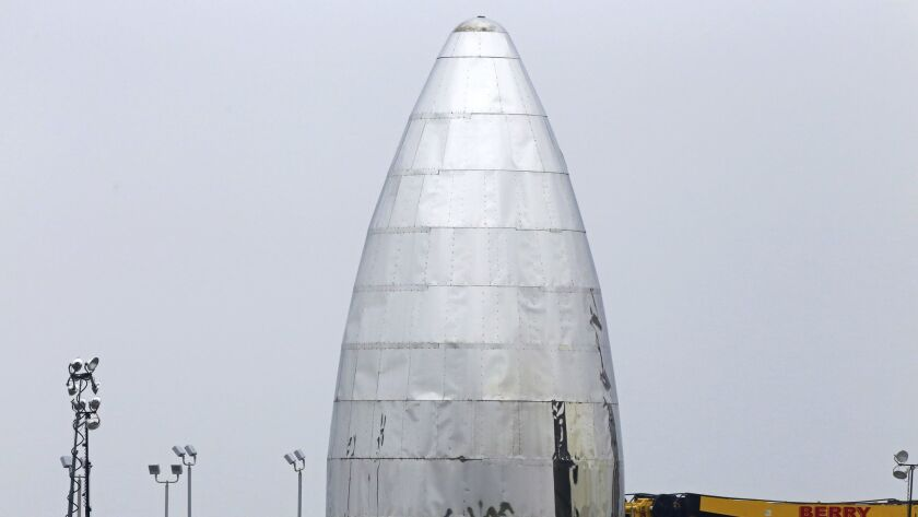 """SpaceX's prototype starship that is being called """"test hopper"""" stands at the Boca Chica Beach site,"""