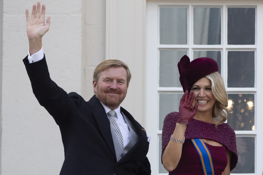 "FILE - In this Tuesday, Sept. 17, 2019 file photo, Dutch King Willem-Alexander and Queen Maxima wave from the balcony of royal palace Noordeinde in The Hague, Netherlands. The Dutch king issued a video message Wednesday saying ""with sorrow in the heart"" that he regrets flying to Greece for a family vacation last week, a trip that was quickly broken off amid public uproar back home where people are being urged to stay home as much as possible to battle the coronavirus. (AP Photo/Peter Dejong, File)"
