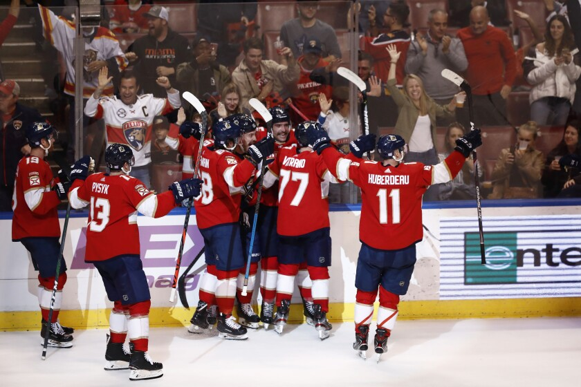The Panthers celebrate after scoring in overtime to beat the Ducks 5-4 on Nov. 21.