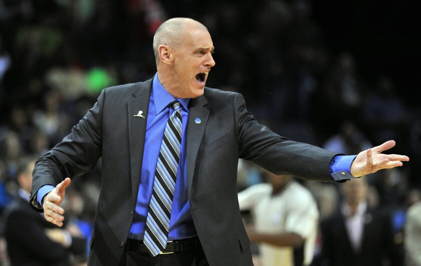 Dallas Mavericks head coach Rick Carlisle shouts at a referee and draws a technical foul in the first half of an NBA basketball game against the Memphis Grizzlies, Saturday, Feb. 6, 2016, in Memphis, Tenn. (AP Photo/Brandon Dill)