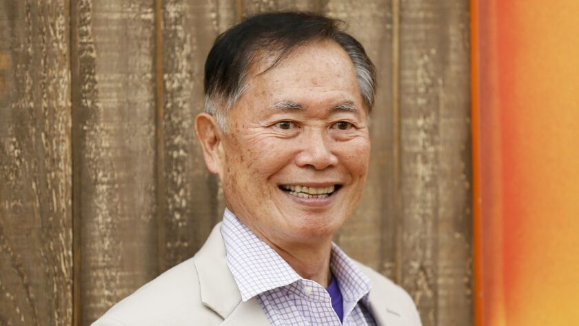 """George Takei poses at world premiere of animated film """"Free Birds"""" in Los Angeles"""