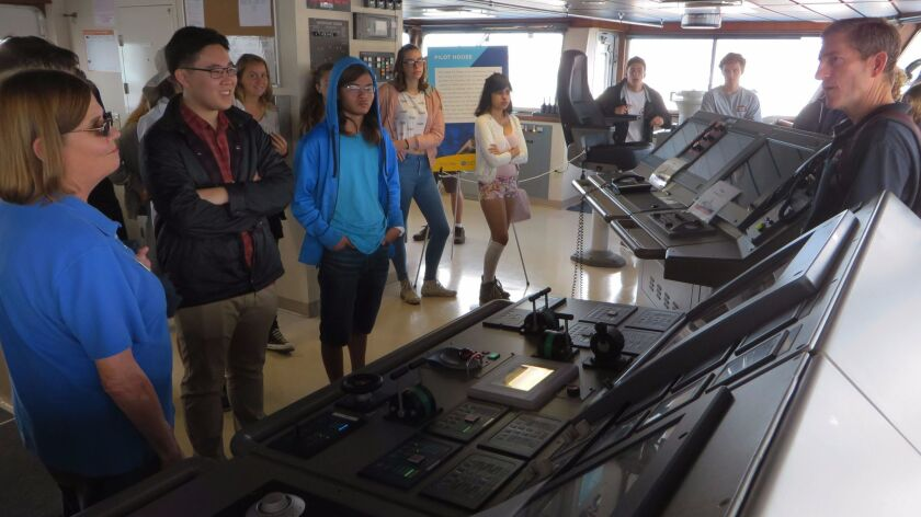 Bruce Applegate from Scripps Institution of Oceanography shows the bridge of the R/V Sally Ride to students from La Jolla High School.