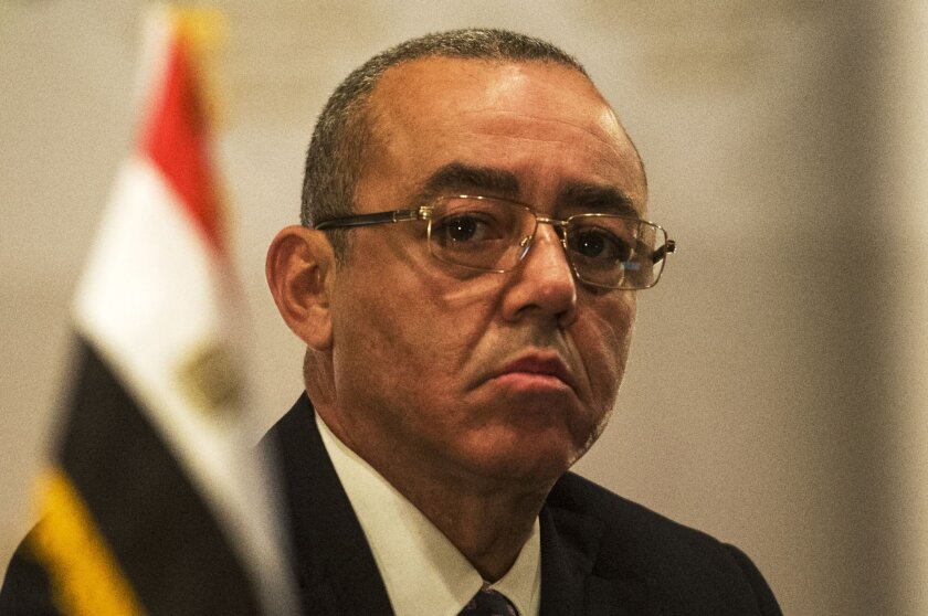 In Cairo, Egyptian Minister of Civil Aviation Hossam Kamal attends a Dec. 22 news conference on airport security.