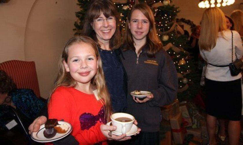 Catherine Delfino (center) and her daughters, Sarah (left) and Annmarie enjoy the Christmas Tea.