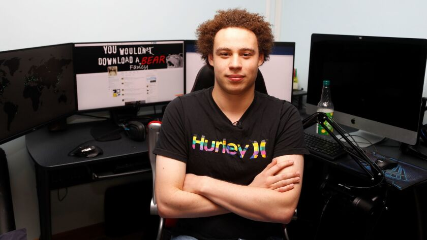 "British IT expert Marcus Hutchis, who has been branded a hero for slowing down the ""WannaCry"" global cyberattack, at his workstation during an interview in Ilfracombe, England, Monday, May 15, 2017."