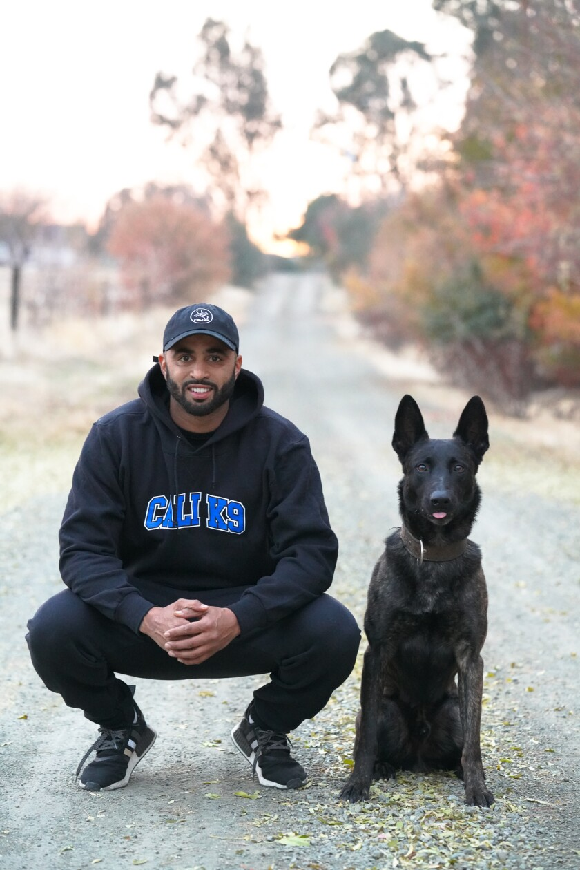 Bay Area dog trainer Jas Leverette with a canine companion