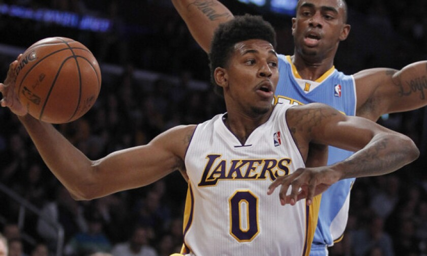 Lakers small forward Nick Young drives inside on Denver Nuggets forward Darrell Arthur during a game on Jan. 5.