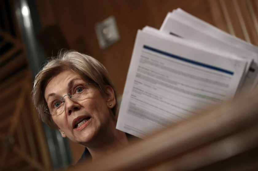 Sen. Elizabeth Warren (D-Mass.) questions Wells Fargo Chief Executive John Stumpf during a Senate Banking Committee hearing on Tuesday.