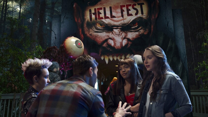 "Bex Taylor-Klaus, left, Christian James, Reign Edwards and Amy Forsyth in the movie ""Hell Fest."""