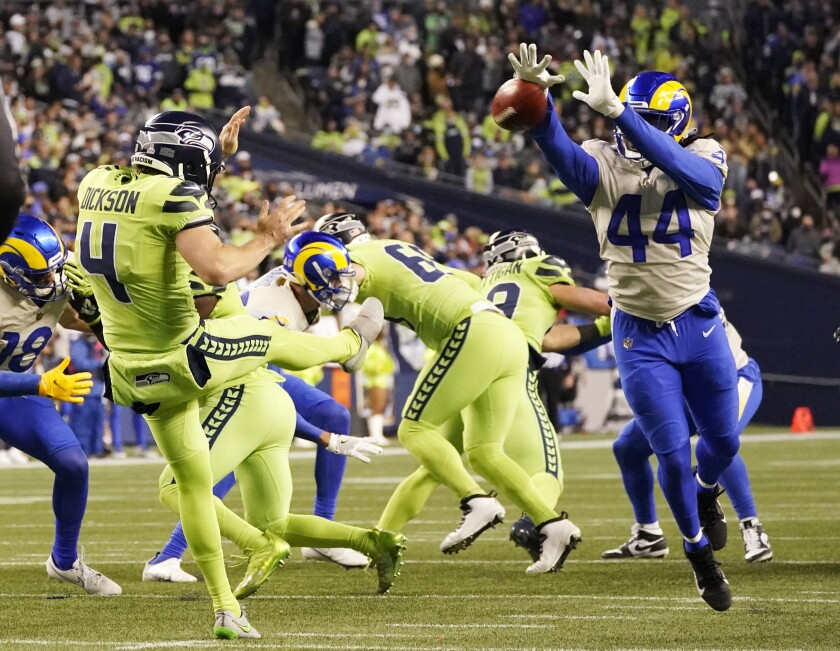 Los Angeles Rams linebacker Jamir Jones (44) blocks a kick by Seattle Seahawks punter Michael Dickson (4) during the second half of an NFL football game, Thursday, Oct. 7, 2021, in Seattle. (AP Photo/Elaine Thompson)