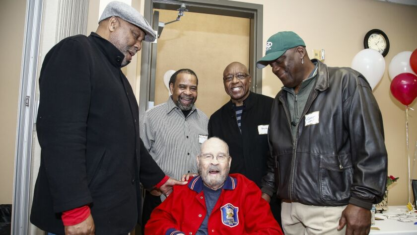 Former Lincoln High players (left to right) Doug Jones, Wally Henry, Jerry Powell and Robert West — all of whom played in the NFL — gathered Saturday to celebrate the 100th birthday of their coach, Shan Deniston.