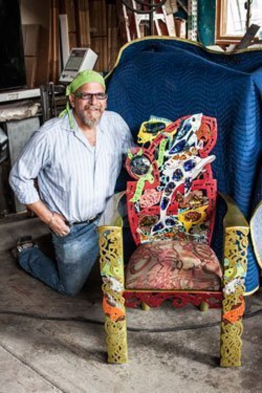 James Stone, at his Stone and Glass studio, with one of the chairs from his fish-centered series 'Last Call Before We Eat Them All.'
