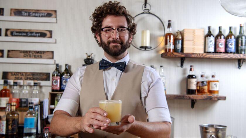 ENCINO, CA-May 1, 2019: Bar master Peyton Tucker prepares one of his signature cocktails, the Akuma'