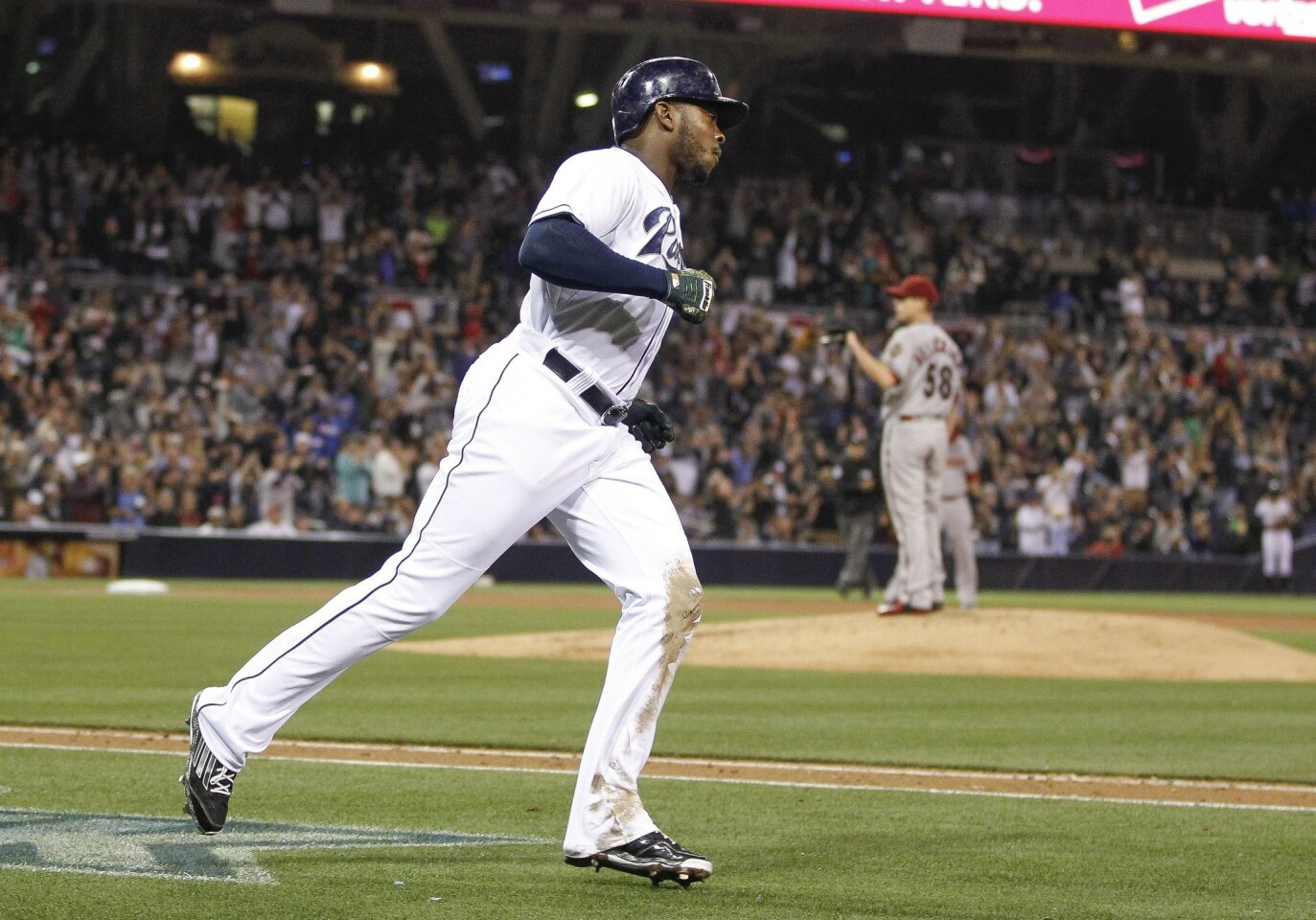 The Padres' Justin Upton runs toward first base as Diamondbacks pitcher Jeremy Hellickson stands at the mound after Upton hit a home run in the fifth inning at Petco Park in San Diego on Tuesday, April 14, 2015. Padres won 5-1.