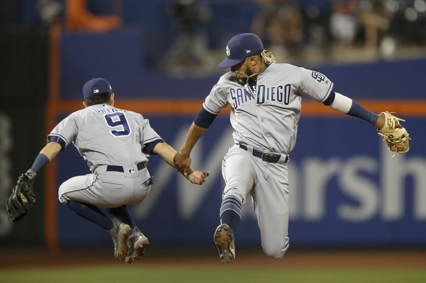 Fernando Tatis Jr. and Luis Urias (9) celebrate the Padres' victory over the Mets on Wednesday.