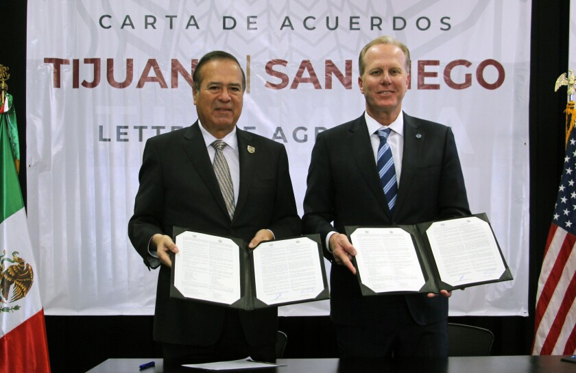 Tijuana Mayor Arturo González Cruz and San Diego Mayor Kevin Faulconer at the signing of the collaboration agreement on Jan. 31, 2020, at the Tijuana Cultural Center.