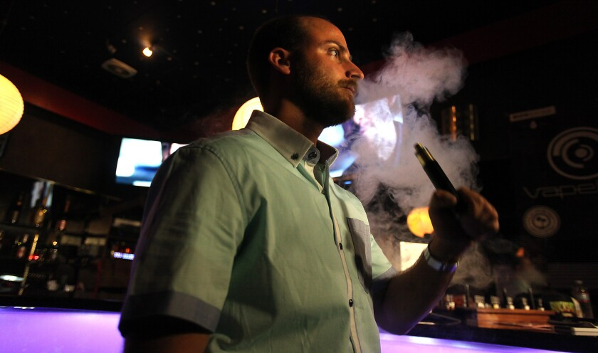 "Daren Hiltunen of Santa Monica exhales vapor from a ""vape"" device at the Cindy Club in Los Angeles on April 18, 2014."