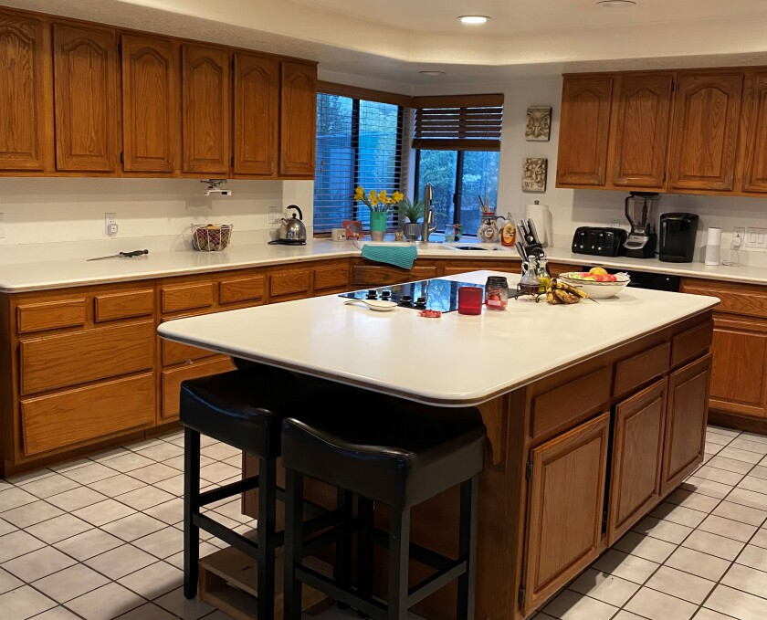 The Palma family's kitchen before their teens got busy giving it a facelift during lockdown.