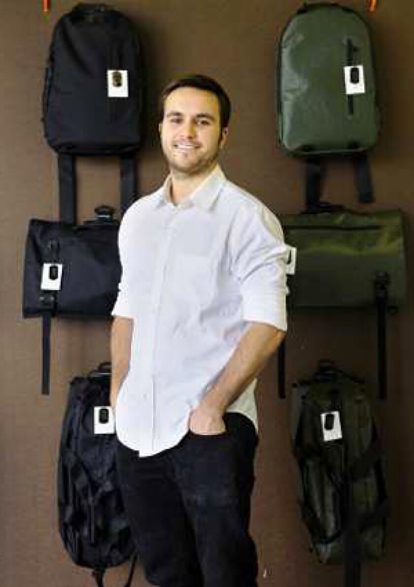 NEW LIFE: Spencer Nikosey made totes out of Army truck tarps and fire hoses.