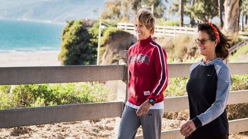 Swimmer Diana Nyad, left, walks in Santa Monica with her EverWalk co-founder Bonnie Stoll.