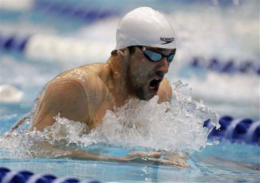 Michael Phelps swims the breaststroke leg in the men's 200-meter individual medley at the Indianapolis Grand Prix swimming meet in Indianapolis, Saturday, March 31, 2012. Phelps won with a time of 1:56.32. (AP Photo/Michael Conroy)