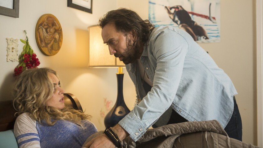 """Nicolas Cage, with Penelope Mitchell, again demonstrates his capacity for fierce commitment to a role in """"Between Worlds."""""""