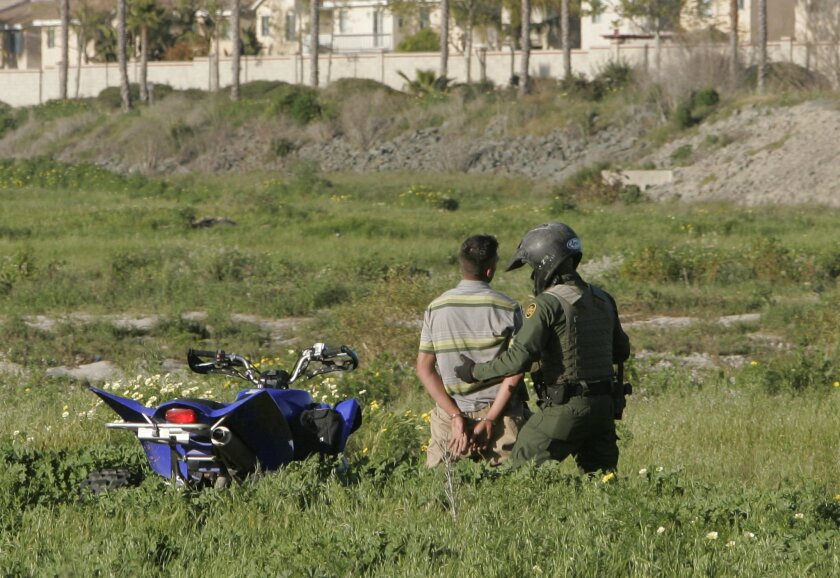 A Border Patrol agent who uses an ATV to patrol apprehends an illegal immigrant. He was seen going over the fence about a mile west of the San Ysidro border crossing. He said he was trying to return to his job in Ontario after visiting family in Mexico's Jalisco state.