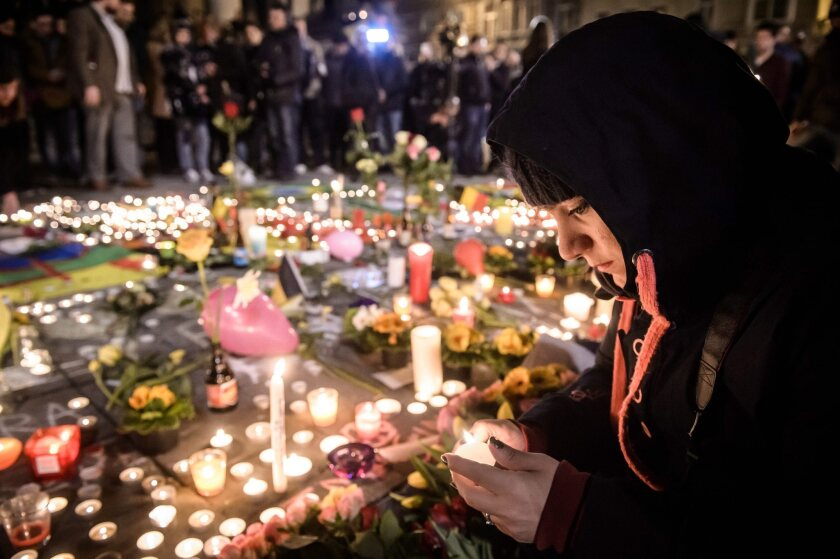 People gather and light candles at the Place de la Bourse during a vigil to pay tribute to the victims of the attacks in Brussels, Belgium on March 22.