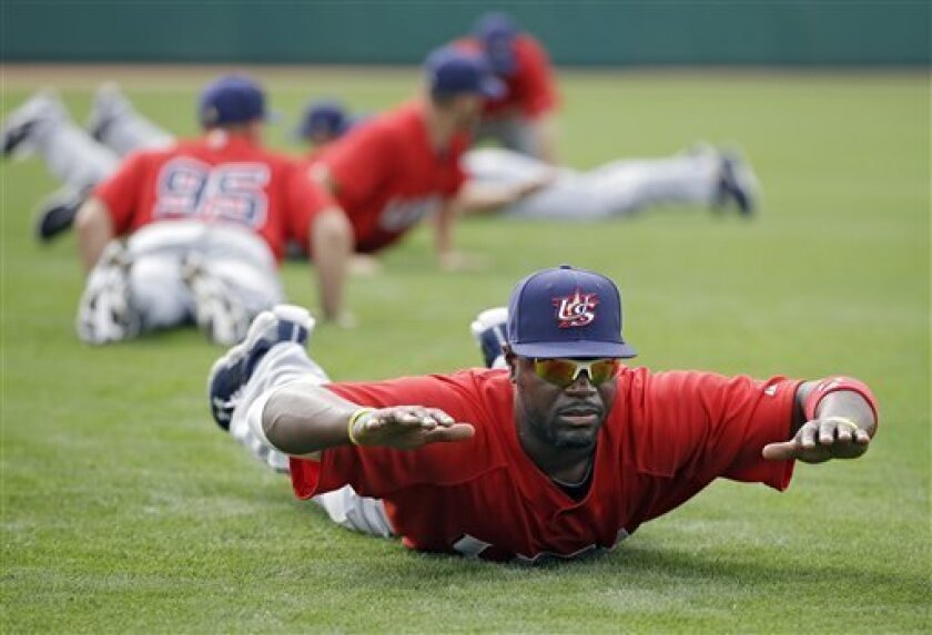 United States' Brandon Phillips stretches before an exhibition baseball game against the Chicago White Sox Tuesday, March 5, 2013, in Glendale, Ariz. The game is the first of two exhibitions the team will play leading up the the start of the World Baseball Classic. (AP Photo/Mark Duncan)