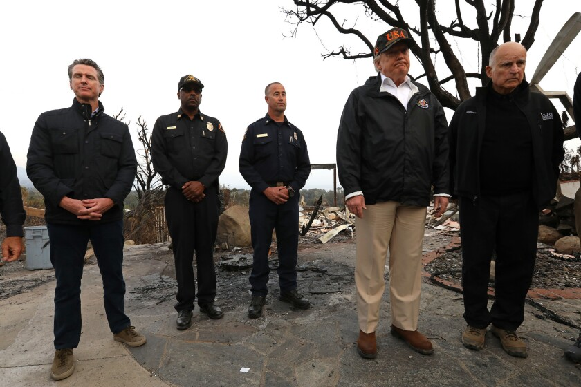 MALIBU, CA ? NOVEMBER 17, 2018 - - President Donald Trump, second from right, frowns while taking i