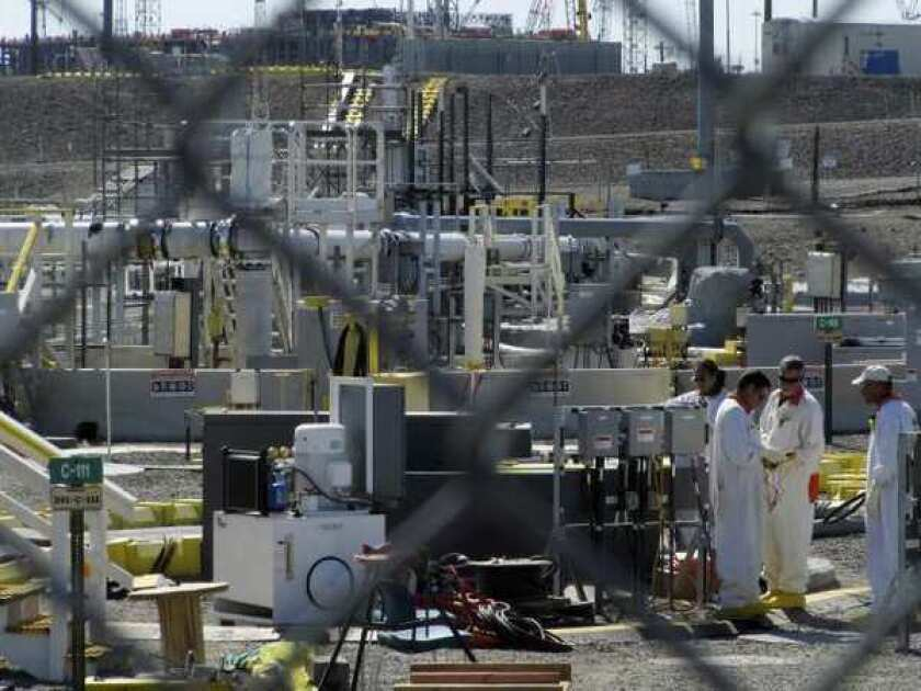 Radioactive material has been found between two layers of a double-shelled storage tank at the Hanford Nuclear Reservation in Richland, Wash.