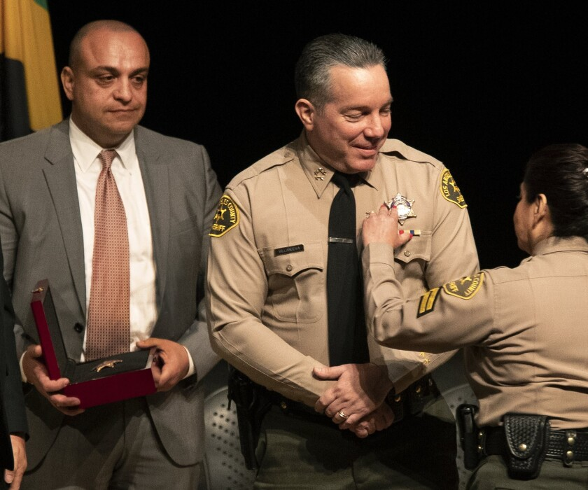 Caren Carl Mandoyan and L.A. County Sheriff Alex Villanueva