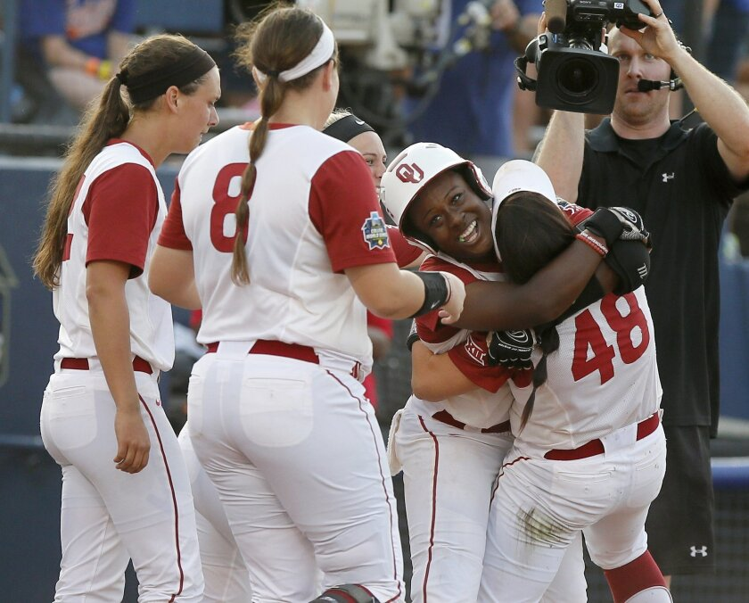 Oklahoma's Shay Knighten celebrates with Erin Miller (48) after hitting a three-run home run to win in the eighth inning of a college softball game against Alabama in Oklahoma City, Friday, June 3, 2016. (Bryan Terry/The Oklahoman via AP) LOCAL STATIONS OUT (KFOR,KOCO,KWTV,KOKH, KAUT OUT); LOCAL IN