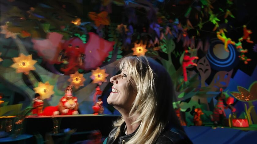 Kim Irvine on It's a Small World in 2009, which at the time was the subject of fan backlash for the addition of Disney characters.