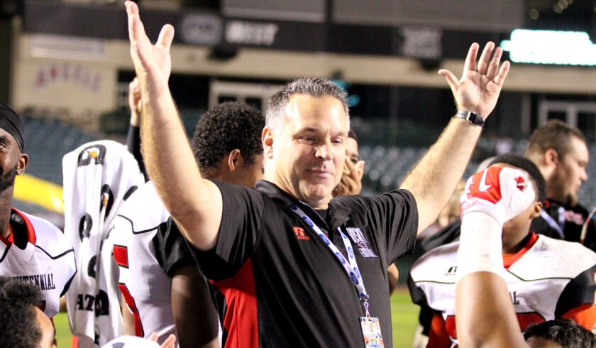 Coach Matt Logan celebrates with his Corona Centennial players during their Pac-5 Division championship victory.