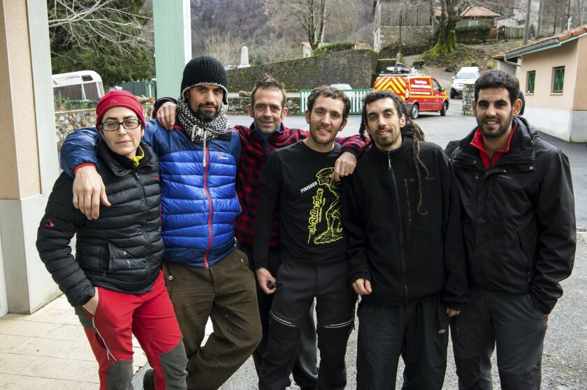 Six of the seven Spanish spelunkers trapped in a cave pose after being rescued in Herran, in the Pyrenees region, Wednesday, Feb. 10, 2016. Officials said that the Spaniards were part of a group of 15 explorers who began a descent on Tuesday afternoon and eventually got trapped. Names are Maria, le
