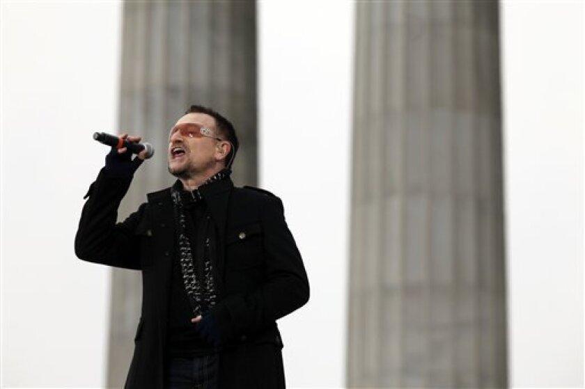 U2 frontman Bono sings at the Lincoln Memorial during President-elect Barack Obama's inaugural concert in Washington, Sunday, Jan. 18, 2009. (AP Photo/Charles Dharapak)